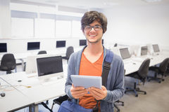 Portrait of happy student holding digital tablet Stock Photography