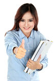 Portrait of happy student holding a few books and thumbs up Royalty Free Stock Photo