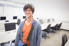 Portrait of happy student standing in computer class Royalty Free Stock Image