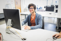 Portrait of happy student using computer Royalty Free Stock Photo