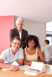 Portrait of happy students with lecturer Stock Photos