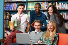 Portrait Of Happy Students In Library. Portrait Of Happy Students Working In Library Royalty Free Stock Image