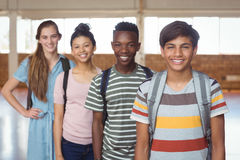 Portrait of happy students standing with schoolbags in campus Royalty Free Stock Photography