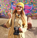 Portrait of happy stylish girl with old retro camera having fun Royalty Free Stock Image