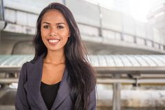 Portrait of a happy successful mature asian business woman street outdoor Royalty Free Stock Photo