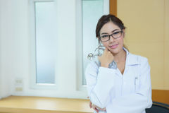 Portrait of happy successful young female doctor holding a steth Stock Photography
