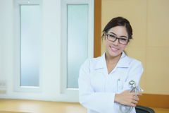 Portrait of happy successful young female doctor holding a steth Stock Images