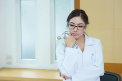 Portrait of happy successful young female doctor Stock Image