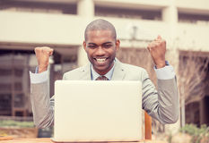 Portrait happy successful young man with laptop computer celebrates success Royalty Free Stock Photography