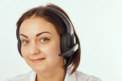 Portrait of happy support phone operator in headset Stock Photo