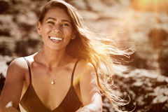 Portrait of happy surfer girl at the beach. summerfeeling Royalty Free Stock Image