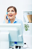 Portrait of happy surprised business woman on phone in white of Stock Image