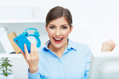 Portrait of happy surprised business woman on phon Stock Photo
