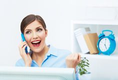 Portrait of happy surprised business woman on phone in white of Royalty Free Stock Photo