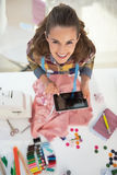Portrait of happy tailor woman using tablet pc Royalty Free Stock Images