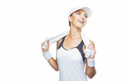 Portrait of Happy Tanned and smiling Caucasian Female Tennis Pla. Young Happy Tanned Caucasian Female Tennis Player Equipped with Professional Tennis Outfit with Stock Images