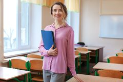 Portrait of happy teacher royalty free stock photo
