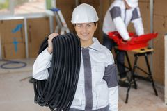 Portrait happy technician holding cable Royalty Free Stock Photo