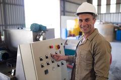 Portrait of happy technician operating a machine. In oil factory Stock Photography