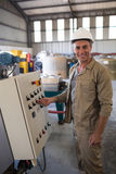 Portrait of happy technician operating a machine. In oil factory Stock Photos