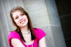 Portrait of a Happy Teen. Head-and-shoulders portrait of a smiling teen by a school pillar stock photos