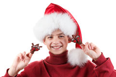 Portrait of happy teen boy in Santa hat with deer toy up isolated on white. Background Royalty Free Stock Images