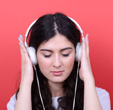 Portrait of happy teen girl dancing and listening music against royalty free stock photos
