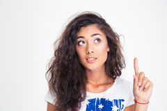 Portrait of a happy teen girl pointing finger up Royalty Free Stock Photo