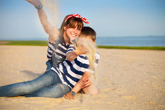 Portrait of happy teen sister and little brother. On the beach Royalty Free Stock Photo