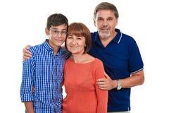 Portrait of happy teenage boy with his grandparents Stock Photo