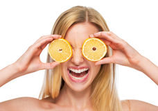 Portrait of happy teenage girl holding lemon in front of eyes Stock Image