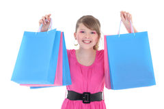 Portrait of happy teenage girl in pink with shopping bags Stock Photography