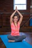 Portrait of happy teenage girl practicing yoga Stock Image