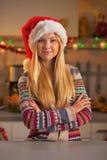 Portrait of happy teenage girl in santa hat in kitchen Stock Images
