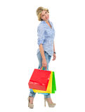 Portrait of happy teenage girl with shopping bags Stock Photo