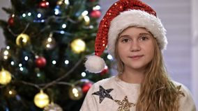 Portrait happy teenage girl smiling happy teen enjoying festive holiday celebration at home, christmas tree in stock video