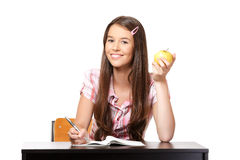 Portrait of a happy teenager with apple Stock Photography