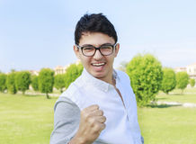 Portrait of happy teenager and sign of victory,successful. Stock Photography