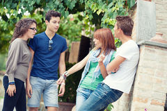 Portrait of happy teens in the park at summer stock photo