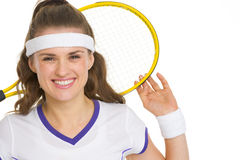 Portrait of happy tennis player holding racket Stock Photos