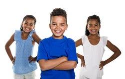 Portrait of happy three black childrens, white background royalty free stock image
