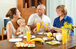 Portrait of  happy three generations family eating  fresh ripe Stock Images