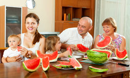 Portrait of  happy three generations family eating  melon Stock Photos