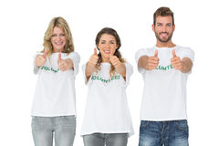 Portrait of happy three volunteers gesturing thumbs up Royalty Free Stock Photo