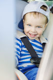 Portrait happy toddler boy sitting in the car Royalty Free Stock Photos