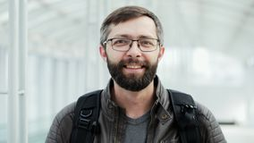 Portrait of happy tourist, bearded man smiling at the airport stock video
