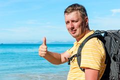 Portrait of a happy traveler on the sea. Background Stock Image