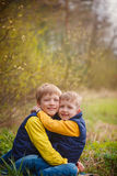 Portrait happy two brothers embracing in sunny day. Royalty Free Stock Image