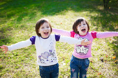 Portrait of happy two little girls twins relaxing and enjoying l royalty free stock images