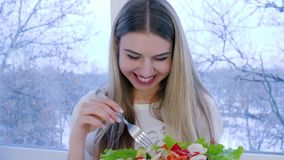 Portrait of happy vegetarian with plate of useful meal on background window. Indoors stock footage